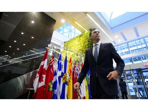 Finance Minister Bill Morneau makes his way to a meeting with his provincial and territorial counterparts in Ottawa on Monday, Dec. 10, 2018.