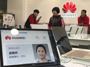 A profile of Huawei's chief financial officer Meng Wanzhou is displayed on a Huawei computer at a Huawei store in Beijing, China, Thursday, Dec. 6, 2018. Canadian authorities said Wednesday that they have arrested Meng for possible extradition to the United States.