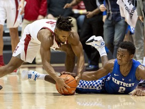 Kentucky guard Ashton Hagans (2) tries for a steal from Alabama guard Avery Johnson Jr. (5) during the first half of an NCAA college basketball game, Saturday, Jan. 5, 2019, in Tuscaloosa, Ala.