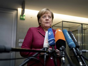 German Chancellor Angela Merkel talks about the decision by British lawmakers to oppose the agreement negotiated by British Prime Minister Theresa May and the EU, during a statement at a parliament building in Berlin, Jan. 16, 2019.