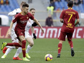Roma's Stephan El Sharaawy runs with the ball during a Serie A soccer match between Roma and Torino, at the Rome Olympic Stadium, Saturday, Jan. 19, 2019.