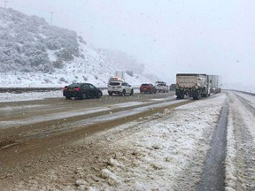 This photo provided by the California Department of Transportation shows traffic stopped on Interstate 5 where it has been closed due to snow at Tejon Pass, an area known as the Grapevine, at Gorman in the Tehachapi Mountains of Southern California, Monday, Jan. 14, 2019. The first in a series of Pacific storms is moving across Southern California, where downpours could unleash mud and debris flows from large wildfire burn scars. (CalTrans via AP)