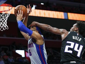 CORRECTS PISTONS PLAYER TO BRUCE BROWN, INSTEAD OF KALIN LUCAS - Sacramento Kings guard Buddy Hield (24) fouls Detroit Pistons' Bruce Brown during the first half of an NBA basketball game in Detroit, Saturday, Jan. 19, 2019.