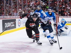 Canada's Maxime Comtois battles Finland's Oskari Laaksonen during the first period of IIHF world junior hockey championship action in Vancouver on Jan. 2, 2019. Canada lost to Finland 2-1 in overtime.