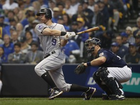 FILE - In this Oct. 5, 2018, file photo, Colorado Rockies' DJ LeMahieu hits a single during the third inning of Game 2 of the National League Divisional Series baseball game against the Milwaukee Brewers, in Milwaukee. A star second baseman for Colorado, LeMahieu is set to join a crowded New York Yankees infield. LeMahieu became a free agent after the season and got a $24 million, two-year contract with the Yankees.