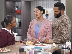 """This image released by ABC shows Marsai Martin, from left, Tracee Ellis Ross and Anthony Anderson in a scene from """"black-ish."""" In the episode airing on Tuesday, Jan. 15, Dre, played by Anderson, and Bow, played by Ross, are furious after Diane, played by Martin, isn't lit properly in her class photo. The episode outlines the history of colorism in depth while injecting some humor."""