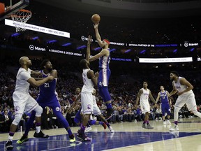 Philadelphia 76ers' Ben Simmons, right, goes up for a shot against Minnesota Timberwolves' Andrew Wiggins during the second half of an NBA basketball game, Tuesday, Jan. 15, 2019, in Philadelphia. Philadelphia won 149-107.
