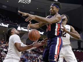 Auburn forward Anfernee McLemore (24) battles for a rebound between Texas A&M guard Savion Flagg, left, and forward Josh Nebo (32) during the first half of an NCAA college basketball game, Wednesday, Jan. 16, 2019, in College Station, Texas.
