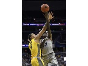 Georgetown forward Josh LeBlanc, right, goes to the basket against Marquette forward Theo John (4) during the second half of an NCAA college basketball game, Tuesday, Jan. 15, 2019, in Washington. Marquette won 74-71.