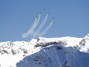 The Patrouille Suisse, an aerobatic team of the Swiss Air Force, flies ahead of an alpine ski, men's World Cup downhill, in Wengen, Switzerland, Saturday, Jan. 19, 2019.