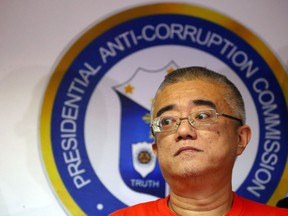 Xie Haojie, who was arrested in Manila in an operation coordinated with Chinese authorities, is presented to the media at a news conference in Manila, Philippines Wednesday, Jan. 16, 2019. Philippine officials have turned over to China the former government official wanted for alleged economic crime and corruption.