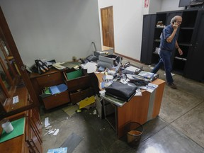"""FILE - In this Dec. 14, 2018 file photo, Confidencial director Carlos Fernando Chamorro, son of former President Violeta Barrios de Chamorro, walks through his ransacked offices while talking on his cellphone in Managua, Nicaragua. The prominent Nicaraguan journalist announced in a video posted to his Confidencial Facebook page on Monday, Jan. 21, 2019 that he had taken """"the painful decision to go into exile to ensure my freedom and physical safety, and above all to carry on independent journalism from Costa Rica."""""""