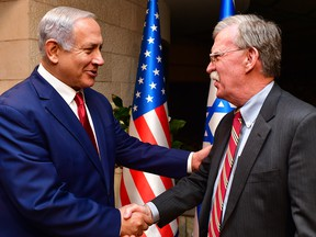 Israeli Prime Minister Benjamin Netanyahu, left, shakes hands with U.S. National Security Adviser John Bolton as they meet on Jan. 6, 2019, in Jerusalem.