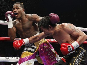 Manny Pacquiao, right, hits Adrien Broner during a WBA welterweight title boxing match Saturday, Jan. 19, 2019, in Las Vegas. (AP Photo/John Locher) ORG XMIT: NVJL201