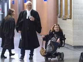 Nicole Gladu, who is incurably ill, and her lawyer Jean-Pierre Menard arrive at the courthouse in Montreal on Monday, January 7, 2019, for the beginning of a trial challenging the provincial and federal laws on medically assisted death on the grounds they are too restrictive.