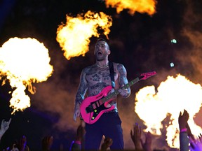 Lead vocalist of Maroon 5 Adam Levine performs during the halftime show of Super Bowl LIII between the New England Patriots and the Los Angeles Rams at Mercedes-Benz Stadium in Atlanta, Georgia, on February 3, 2019.