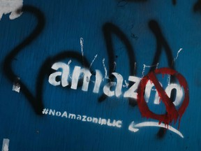 Anti Amazon graffiti is displayed in the Long Island City neighborhood on February 09, 2019 in New York City. According to recent reports, Amazon is reconsidering its plan to locate one of its new headquarters in Long Island City due to the opposition the project has received locally.