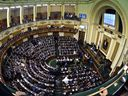 FILE - This Jan. 10, 2016 file photo, shows members of Egypt's Parliament during the inaugural session, the first to convene in three years, in Cairo. Egypt's parliament debated a motion on Tuesday, Feb. 5, 2019, to amend the constitution in a way that could allow President Abdel-Fattah el-Sissi to stay in office well beyond the end of his current term in 2022.