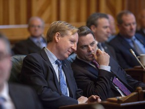 New Brunswick Progressive Conservative MLA Dominic Cardy, left and New Brunswick Progressive Conservative MLA Jake Stewart, talk prior to the Throne Speech at the New Brunswick Legislature in Fredericton, N.B., on Tuesday, Nov. 20, 2018. New Brunswick's education minister says there are serious concerns with the province's French immersion program, and he's asking for public input on how to fix it.