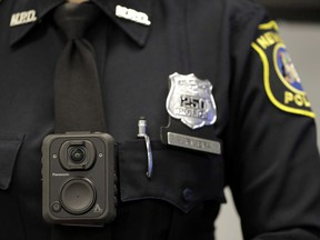 Montreal this week became the latest city in North America to decide against arming police with cameras. Newark police officer Veronica Rivera displays how a body cam is worn during a news conference unveiling the department's new cameras at the Panasonic headquarters in Newark, N.J., Wednesday, April 26, 2017.