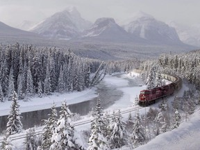 A Canadian Pacific freight train travels around Morant's Curve near Baker Creek, Alta. on Monday, December 1, 2014. A feasibility study released today says bus or passenger rail service between Calgary and Banff National Park would make sense.