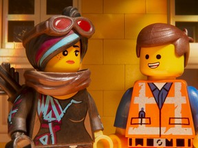 Lucy/Wyldstyle, voiced by Elizabeth Banks, left, and Emmet, voiced by Chris Pratt.