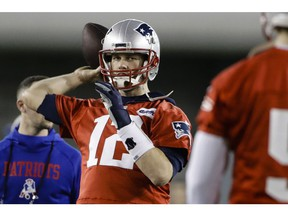 New England Patriots quarterback Tom Brady throws a pass during NFL football practice, Friday, Feb. 1, 2019, in Atlanta, as the team prepares for Super Bowl 53 against the Los Angeles Rams.