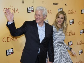 U.S. actor Richard Gere and his partner Alejandra Silva pose on the red carpet as he arrives for the premiere of the film 'The Dinner' in Madrid. Gere and his wife are now parents to a baby boy, Gere's second child.