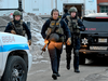Law enforcement officers at the scene of a mass shooting at the Henry Pratt Co. on Feb. 15, 2019, in Aurora, Illinois.