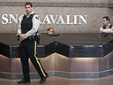 RCMP officers guard the lobby of the SNC-Lavalin head office in Montreal as a raid is carried out the company, April 13, 2012.