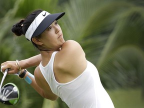 FILE - In this March 4, 2017, file photo, Michelle Wie of the United States tees off on the 2nd hole during the HSBC Women's Champions golf tournament at Sentosa Golf Club's Tanjong course in Singapore. The LPGA Tour completes its four-week swing through Australia and Asia with a healthy Wie defending her title at the 2019 HSBC Women's World Championship at the course.