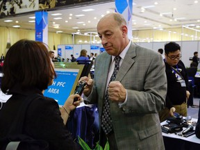 In this Wednesday, Feb. 27, 2019, photo, Robert Constantini, the White House correspondent for Westwood One News, a U.S radio news network, talks to a journalist at the media center in Hanoi, Vietnam. In welcoming more than 2,600 foreign journalists, Vietnam has a unique opportunity to polish its image and, hopefully, boost tourism and investment. Vietnamese are keen to show themselves as members in good standing of the global community, to the extent of helping broker a major diplomatic entente as North Korean leader Kim Jong Un and U.S. President Donald Trump meet for a second time to discuss North Korea's nuclear program.