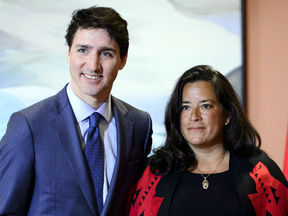 Prime Minister Justin Trudeau and new Veterans Affairs Minister Jodie Wilson-Raybould at a swearing in ceremony in Ottawa on Jan. 14, 2019.