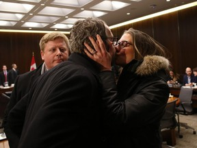 Gerald Butts, former principal secretary to Canada's Prime Minister Justin Trudeau, receives a kiss from his wife Jody after testifying at the House of Commons justice committee on Parliament Hill in Ottawa on March 6, 2019 in Ottawa.
