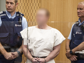 Brenton Tarrant (his identity obscured due to court order) is lead into the dock for his appearance for murder in court on March 16, 2019 in Christchurch, New Zealand.