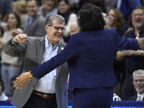 Connecticut head coach Geno Auriemma, left, and Buffalo head coach Felisha Legette-Jack embrace at the start of a second-round women's college basketball game in the NCAA tournament, Sunday, March 24, 2019, in Storrs, Conn.