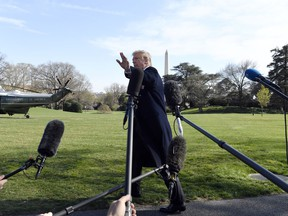 President Trump talks to reporters before leaving on Marine One on the South Lawn of the White House in Washington, Thursday, March 28, 2019, for the short trip to Andrews Air Fore Base in Maryland. Trump is traveling to Michigan to speak at a rally before spending the weekend at his Mar-a-Lago estate in Florida.