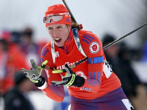 FILE - In this Feb. 11, 2016, file photo, Susan Dunklee, of Barton, Vt., skis to a second-place finish in the sprint competition during the World Cup Biathlon, in Presque Isle, Maine. The Americans have never won an Olympic medal in biathlon. The organization for the sport that combines cross-country skiing and rifle shooting is trying to change that with a revamped blueprint.
