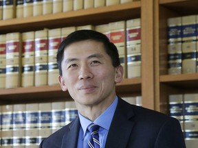 FILE - In this Jan. 13, 2017 file photo California Supreme Court Associate Justice Goodwin Liu pauses in his office in San Francisco. The California Supreme Court justice says the death penalty system in the most populous state is dysfunctional, expensive and doesn't deliver justice in a timely way.  Liu made the comments in an unusual opinion issued Thursday, March 28, 2019, after the full court unanimously upheld Thomas Potts' death sentence. Potts was convicted in a 1997 killing of an elderly couple.