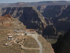 In this March 20, 2007, file photo, the Skywalk hangs over the Grand Canyon on the Hualapai Indian Reservation before its grand opening ceremony at Grand Canyon West, Ariz.