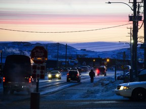 People make their way through Iqaluit, Nunavut. The territory marks its 20th anniversary on Monday.