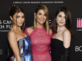 "Actress Lori Loughlin poses with daughters Olivia Jade Giannulli, left, and Isabella Rose Giannulli at ""An Unforgettable Evening"" in Beverly Hills, Calif., on Feb. 28, 2019."