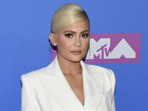 FILE - In this Monday, Aug. 20, 2018 file photo, Kylie Jenner arrives at the MTV Video Music Awards at Radio City Music Hall in New York. At 21, Jenner has been named the youngest-ever, self-made billionaire by Forbes magazine in March 2019.