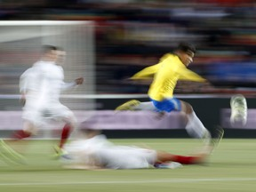 Brazil's Philippe Coutinho jumps to avoid a tackle during the international friendly soccer match between the Czech Republic and Brazil at the Sinobo stadium in Prague, Czech Republic, Tuesday, March 26, 2019.