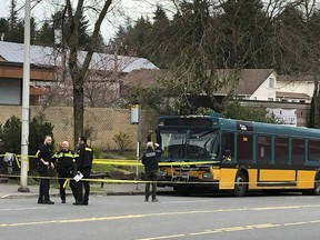 Investigators work on the scene of a shooting in Seattle on Wednesday, March 27, 2019. Authorities say four people, including a Metro bus driver, were shot and one person has been detained.