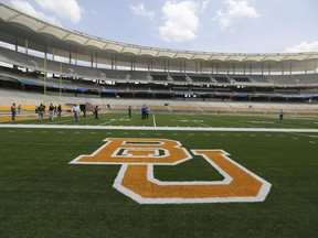 """FILE - In this Aug. 18, 2014, file photo, the Baylor University logo is displayed on the football field at McLane Stadium in Waco, Texas. A federal judge has ordered a law firm to turn over thousands of records that lawyers say should give a fuller accounting of how Baylor University responded to sexual assault allegations made by students. Judge Robert Pitman ruled Thursday, March 28, 2019, that Philadelphia-based Pepper Hamilton must produce all materials related to its internal review that resulted in a 2016 summary report finding """"institutional failure at every level."""""""