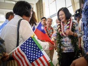 In this Wednesday, March 27, 2019, photo released by the Taiwan Presidential Office, Taiwanese President Tsai Ing-wen, right, is greeted by supporters upon arriving in Hawaii. Speaking during the visit to Hawaii on Wednesday, Tsai said requests have been submitted to the U.S. for F-16V fighters and M1 Abrams tanks. If approved, the move could set off new tensions between the U.S. and China, which considers Taiwan its own territory to be annexed by force if necessary. (Taiwan Presidential Office via AP)