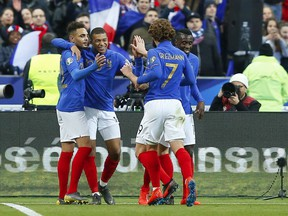 France's Kylian Mbappe, second from right, celebrates after scoring his side's third goal during the Euro 2020 group H qualifying soccer match between France and Iceland at Stade de France stadium in Saint Denis, outside Paris, France, Monday, March 25, 2019.