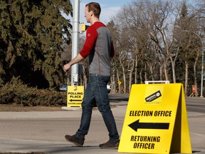 A man heads to an advance polling location at the former Royal Alberta Museum in Edmonton, on Tuesday, April 9, 2019.