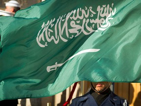 In this March 22, 2018 file photo, an Honor Guard member is covered by the flag of Saudi Arabia as Defense Secretary Jim Mattis welcomes Saudi Crown Prince Mohammed bin Salman to the Pentagon with an Honor Cordon, in Washington Saudi Arabia's Interior Ministry said Tuesday, April 23, 2019, that 37 Saudi citizens have been beheaded in a mass execution that took place across various regions of the country. Saudi King Salman ratified the executions for terrorism-related crimes by royal decree.